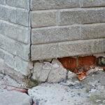 house with a broken foundation pillar