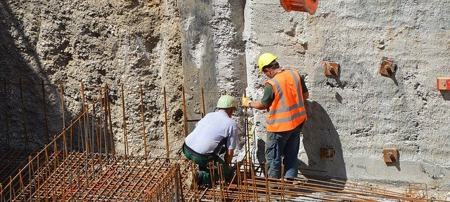 men building foundation
