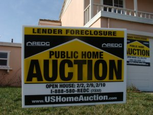 foreclosure auction notice sign in yard of a house