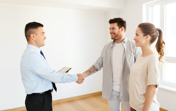 happy couple selling their house to a home investor without any pressure