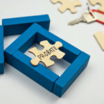 wooden Model house and wooden puzzle with text probate on white background