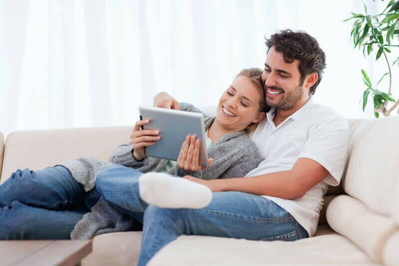 Happy young couple selling their house online in Kansas City