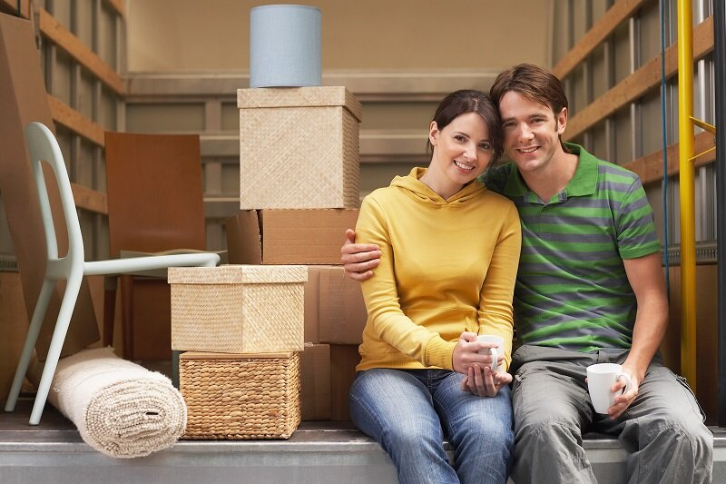 a happy couple who is moving in Mission KS