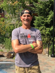 We buy houses in salem, OR. Picture of Ed from West Coast Property Group at Ironman Canada.