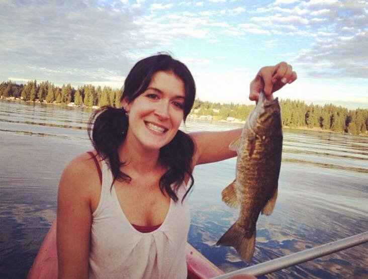 Amy Wagner- Real Estate Agent, fishing on Lake Goodwin a caught fish in hand
