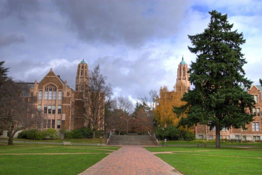 View of University of Washington, brick building with evergreen trees around.