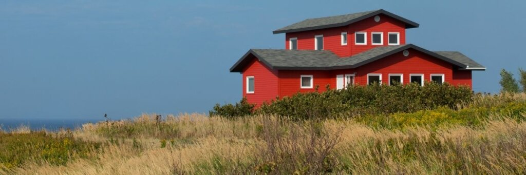 red house sourounded by lots of land
