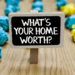 Text sign showing What is Your Home Worth question with paper lumps background