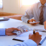 home investor and seller closing deal without closing costs