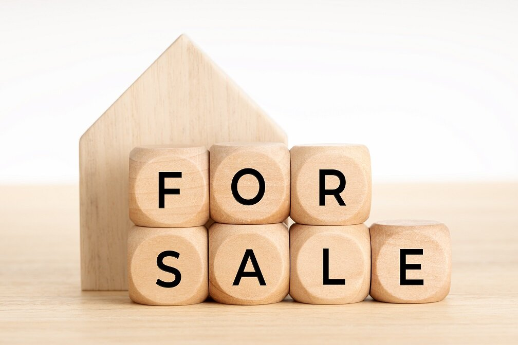 For Sale concept. Real estate market. Wooden blocks with text and house icon. Copy space. White background