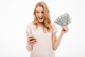 Lady holding cash and phone