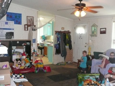 Living room leading into kitchen & front door