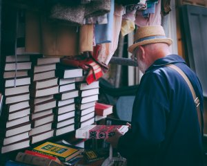 Man shopping for books at yard sale