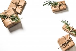 Small gifts elegantly wrapped with bows and plants