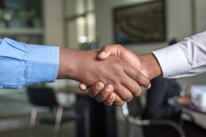 Shaking hands making a deal