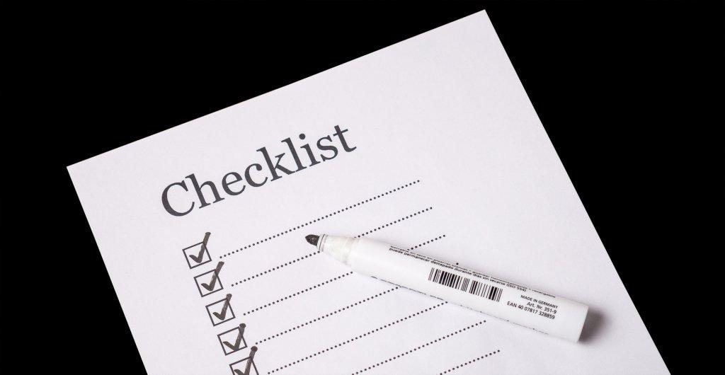 Checklist with a pen