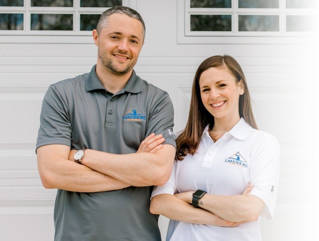 Ryan and Danielle arms folded with Lakeshore Home Buyer shirt