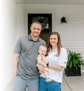 Ryan and Danielle with Lucy and Lakeshore Home Buyer shirts