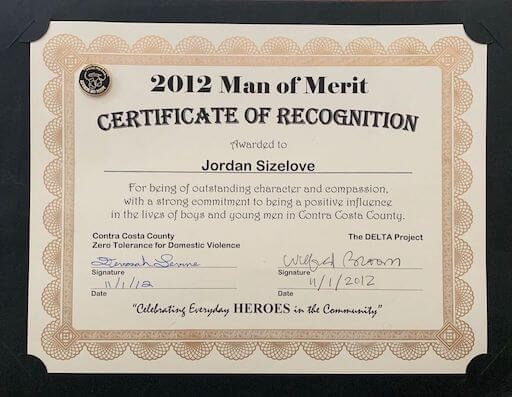 About Us - 2012 Man Of Merit