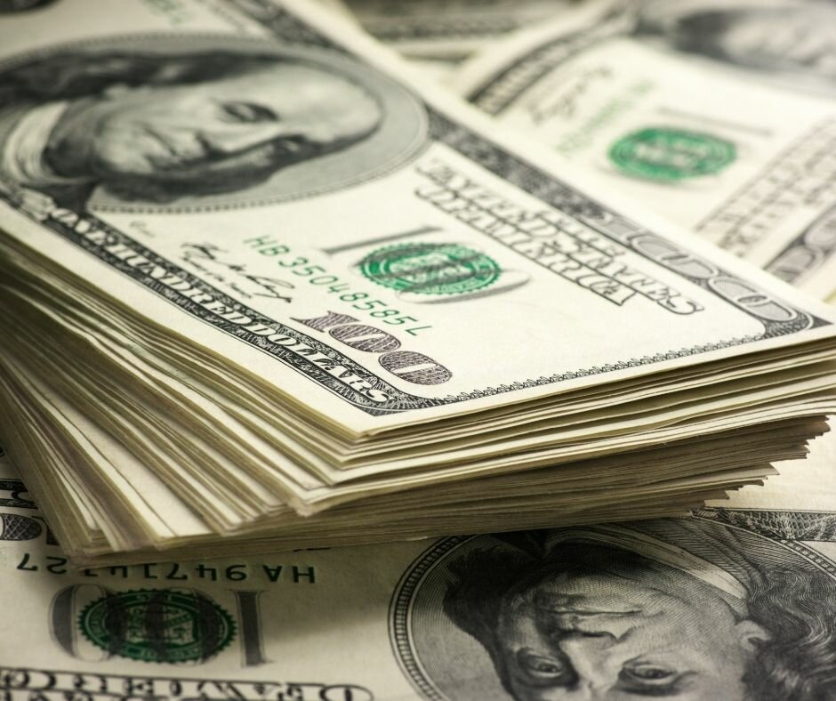 stack of cash to sell your house