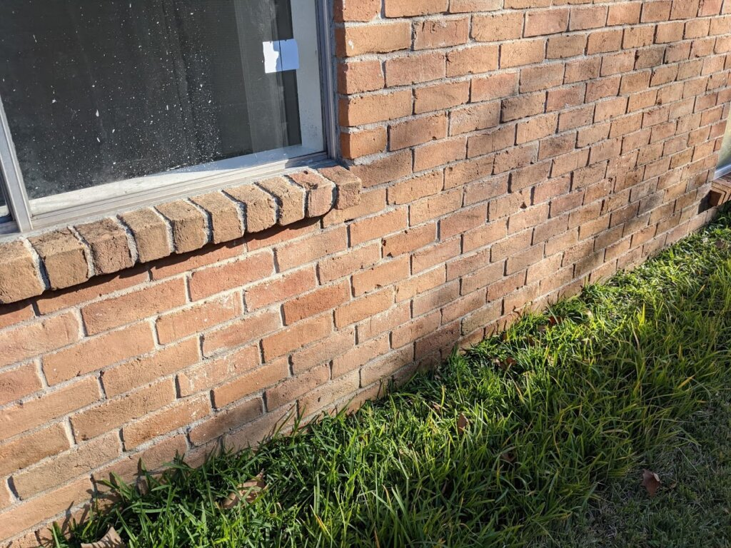 soil is sloping toward the house above the foundation