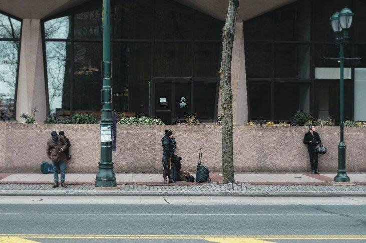 Three millennials waiting for a bus in Philadelphia