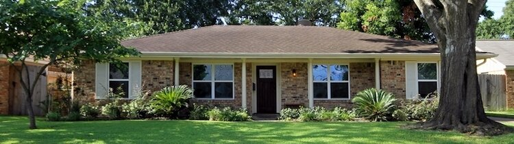 banner with home with a large tree in front of it when sellers selling their houses in greenville nc