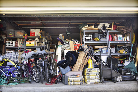 cluttered garage of a home that was going to do a virtual tour