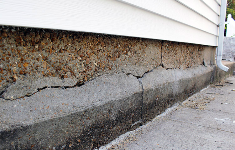 Large crack in concreted showing expensive repairs to avoid when selling your house in greenville nc