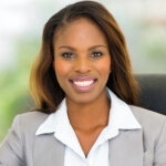 Picture of woman from a credible home buying company smiling and looking at the camera