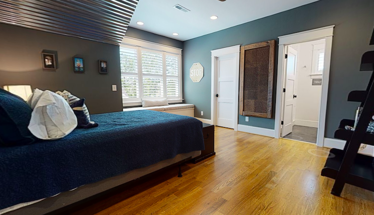Bedroom virtual tour with a green bed which helps you sell your house fast in greenville nc