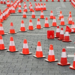 obstacles homeowners face in Greenville NC illustrated by a lot of traffic cones on a blacktop