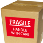 Box with Fragile label showing how you can be Organize When Buying or Selling in greenville nc