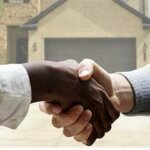 People shaking hands after selling your house directly in Greenville nc