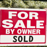For sale by owner sign marked sold while sell your house in Greenville NC