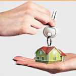 Hand holding keys exchanging for a house held in another hand while selling your house faster in Greenville nc