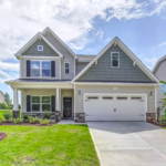 gray house with green grass and a garage when selling a house in greenville nc