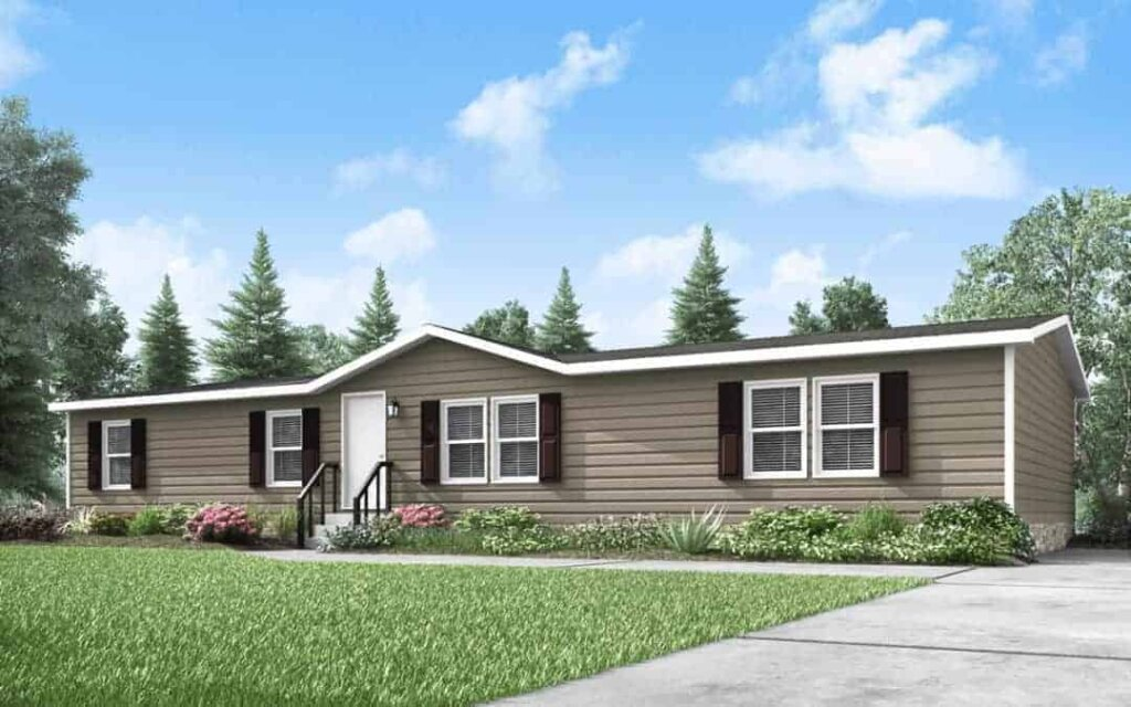picture of a brown mobile home with big front yard