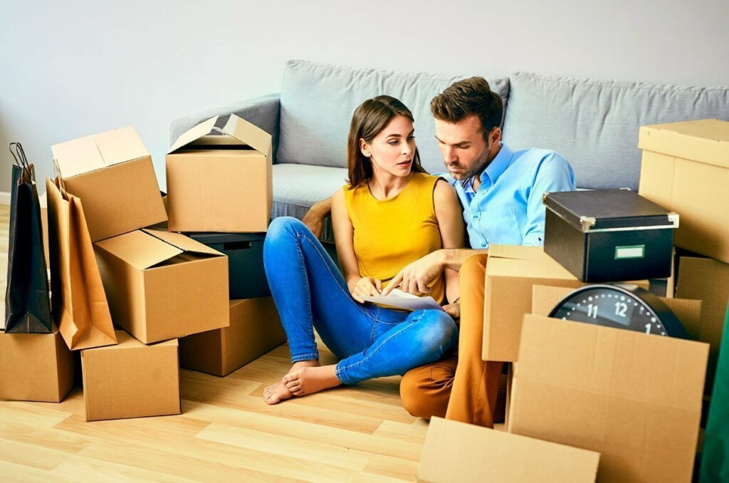 man and woman moving out of there home