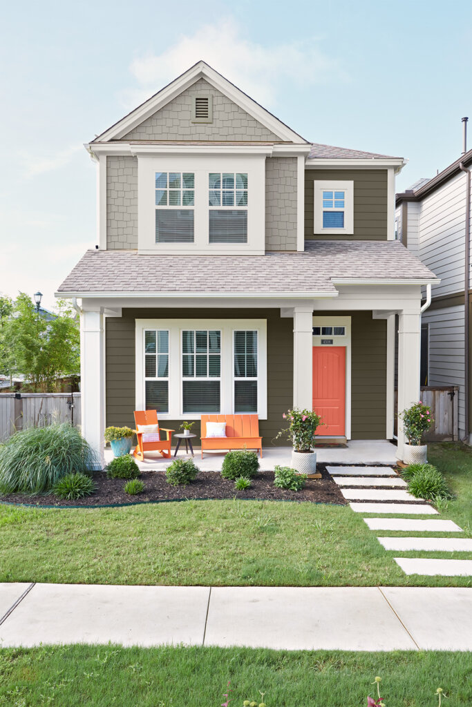 Image of a grey house with a green yard.