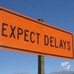sign reading expect delays when you delay the closing in greenville nc