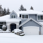 two story home with snow all over it