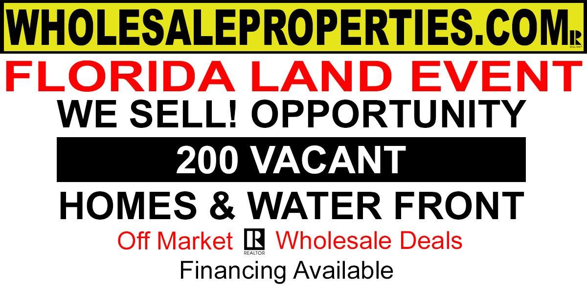 Wholesale Properties.Com logo