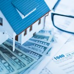 tax consequences when selling a house I inherited | house on cash glasses