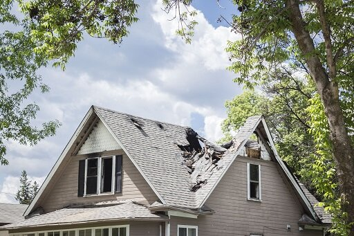Sell my house as is with damaged roof