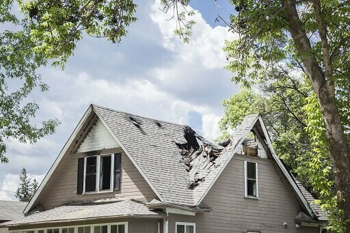 sell house as is with damaged roof in Summit County OH
