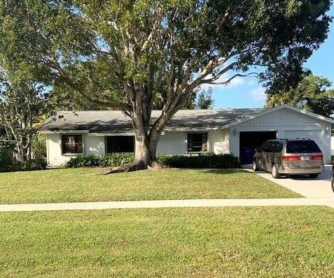 401 La Mancha Ave Royal Palm Beach, FL 33411