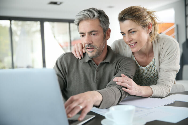 couple researching their homes  market value in the internet