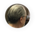 a picture of the back of a man's head that has grey hair and glasses