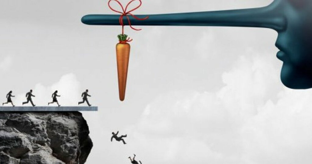 a large face with a long nose and a carrot tied to the end of it enticing people to come get it and fall off a cliff